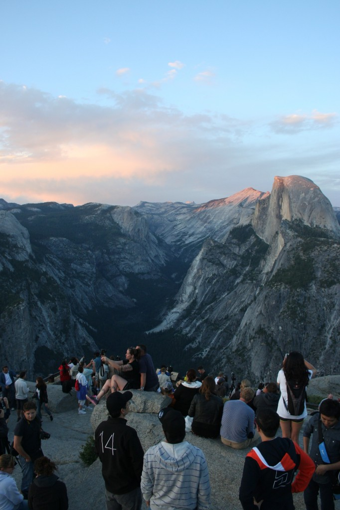 People gathered at Glacier Point to watch the sunset over Half Dome